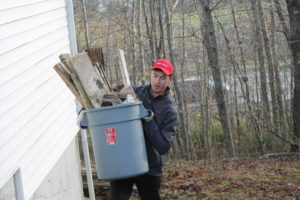 Andrew Willison with the first bucket full of debris being brought up to the truck. (Healey photo)
