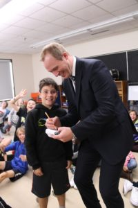 Council candidate Kevin Copley gives a student at BBK School an autograph after his presentation. (Healey photo)