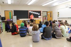 Lisa Blackburn speaks to students at BBK school. (Healey photo)