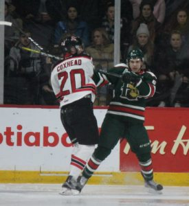 Andrew Coxhead and a Halifax Moosehead battle for net position on Nov. 24 (Healey photo)